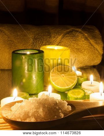 Spa and wellness setting green and yellow candles lit, lemon Green