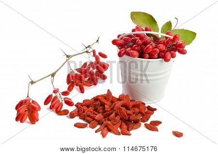 Metal Bucket With Berberries Near Heap Of Goji Berries  Isolated On White Background