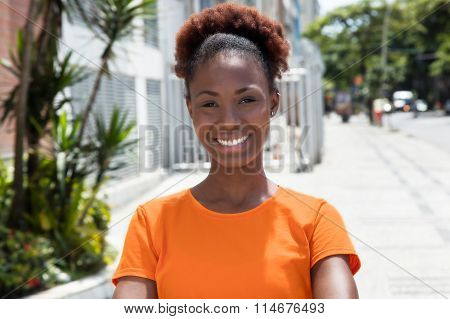 Beautiful African Woman In A Orange Shirt