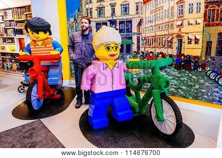 COPENHAGEN, DENMARK - JANUARY 3, 2015: Little Lego men in human scale made of a lot of Lego bricks i