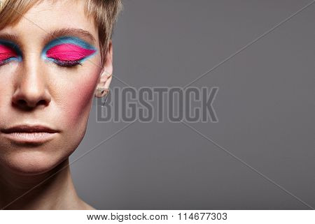 Woman With A Closed Eyes Wears A Bright Matte Eyeshadows