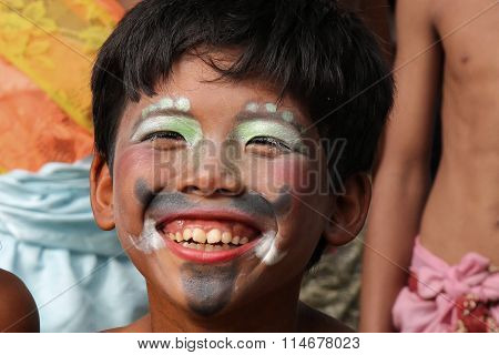 Boy Plays During A Traditional Festival