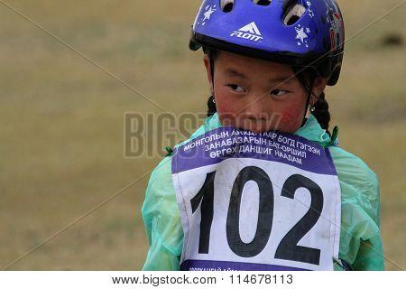 Young Girl Rides During Naadam