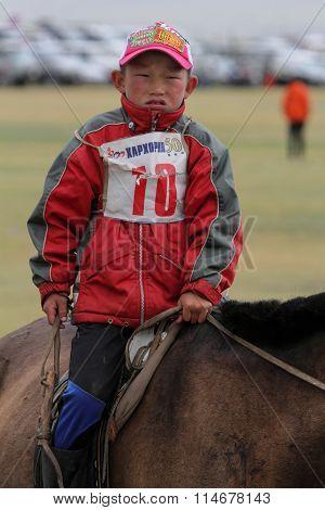 Young Boy Rides During Naadam