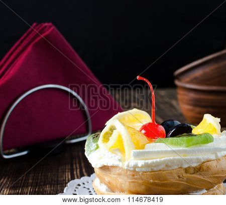 Choux Pastry With Fresh Fruit On A White Napkin