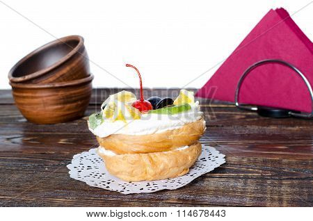 Choux Pastry On The Wooden Table