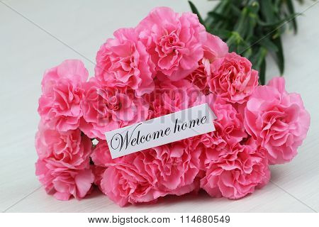 Welcome home card with pink carnation flower bouquet