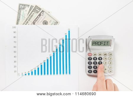 Businessman counting losses and profit working with statistics, analyzing financial results
