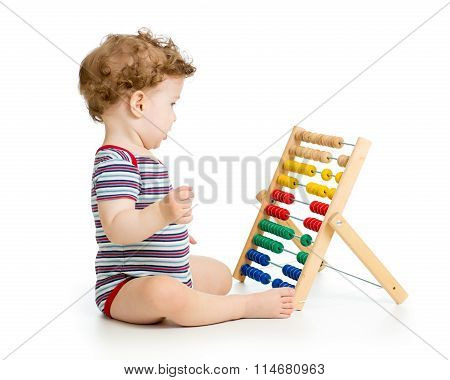 Child playing with abacus toy. Concept of early learning child