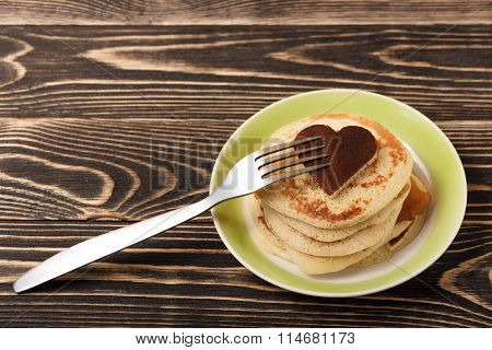 stack of pancakes on wooden board