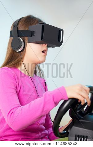 Young girl holding a gaming computer wheel getting experience using VR-headset glasses
