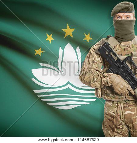 Soldier Holding Machine Gun With Flag On Background Series - Macau