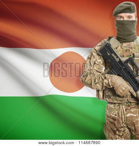 Soldier Holding Machine Gun With Flag On Background Series - Niger