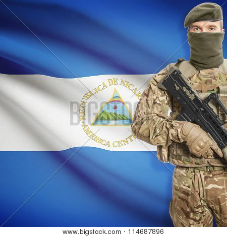 Soldier Holding Machine Gun With Flag On Background Series - Nicaragua
