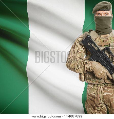 Soldier Holding Machine Gun With Flag On Background Series - Nigeria