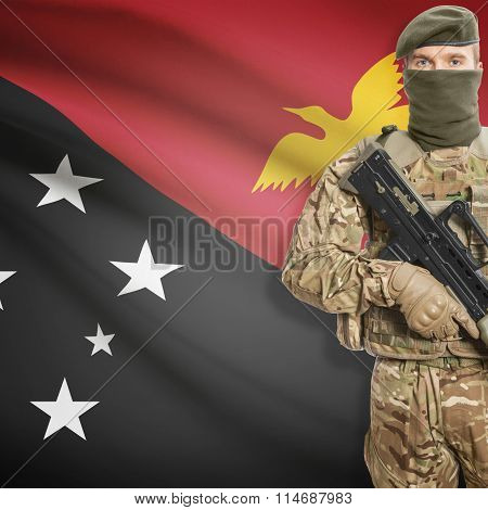 Soldier Holding Machine Gun With Flag On Background Series - Papua New Guinea