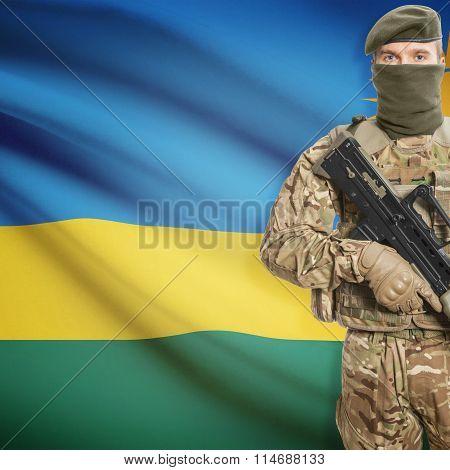 Soldier Holding Machine Gun With Flag On Background Series - Rwanda