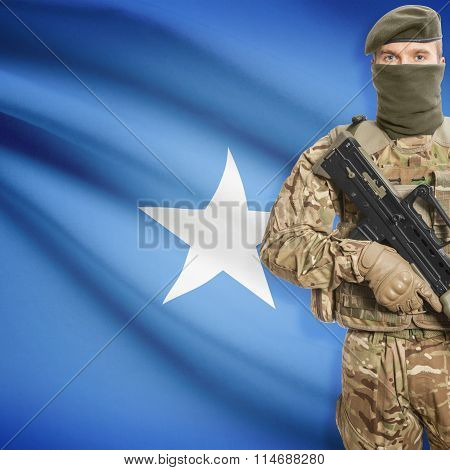 Soldier Holding Machine Gun With Flag On Background Series - Somalia