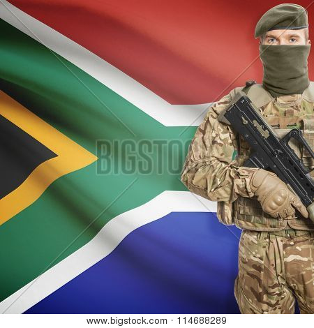 Soldier Holding Machine Gun With Flag On Background Series - South Africa