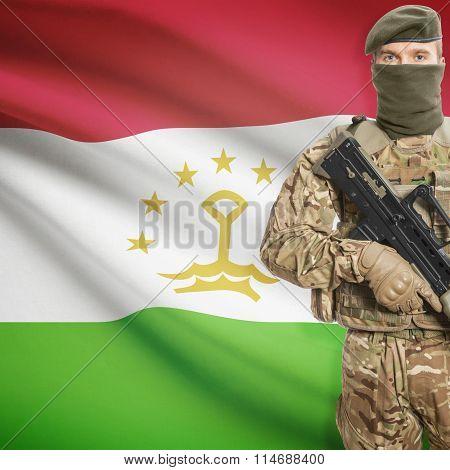 Soldier Holding Machine Gun With Flag On Background Series - Tajikistan