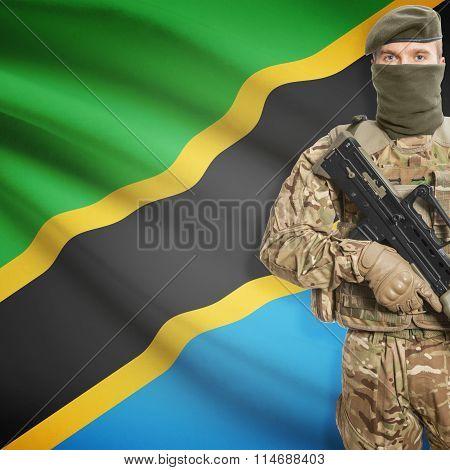 Soldier Holding Machine Gun With Flag On Background Series - Tanzania
