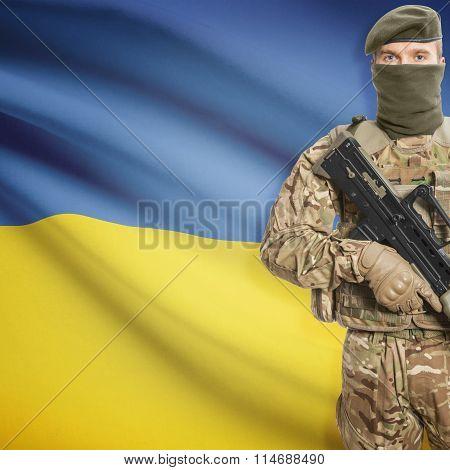 Soldier Holding Machine Gun With Flag On Background Series - Ukraine