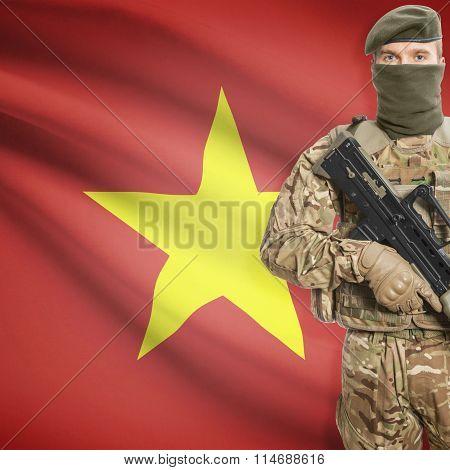 Soldier Holding Machine Gun With Flag On Background Series - Vietnam