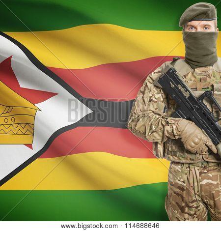 Soldier Holding Machine Gun With Flag On Background Series - Zimbabwe