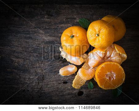 Still Life Oranges Fruit On Texture Wood.