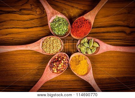 Colorful Spices On Wood