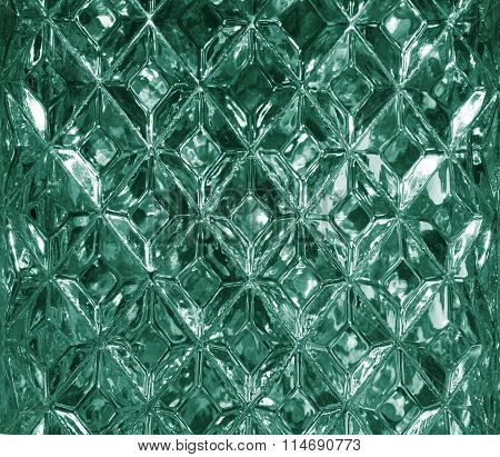 Green glass texture with a pattern of rhombuses. Clear glass diamond shape. Crystals. Closeup