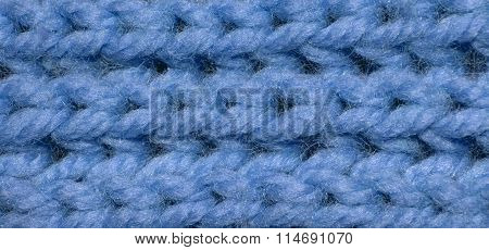 Blue fabric texture with stitched hooks. Fabric texture for the background. Closeup