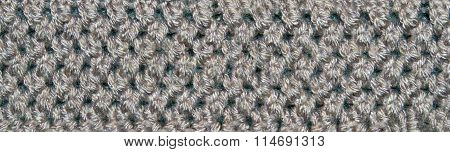 White and black texture animal fur sewn crochet with fibers and hair. Closeup