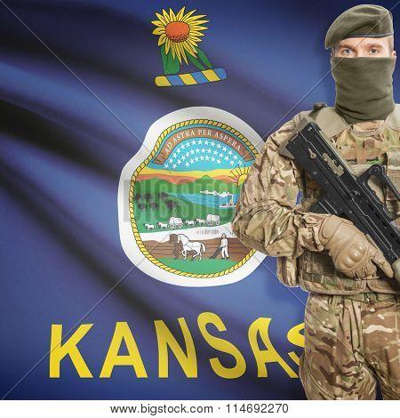 Soldier Holding Machine Gun With Usa State Flag On Background Series - Kansas