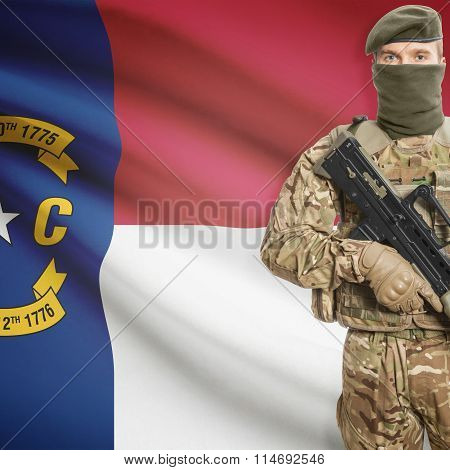 Soldier Holding Machine Gun With Usa State Flag On Background Series - North Carolina