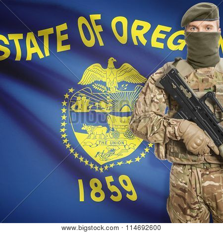 Soldier Holding Machine Gun With Usa State Flag On Background Series - Oregon