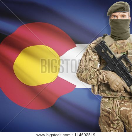 Soldier Holding Machine Gun With Usa State Flag On Background Series - Colorado