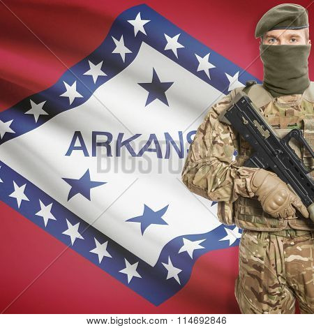 Soldier Holding Machine Gun With Usa State Flag On Background Series - Arkansas