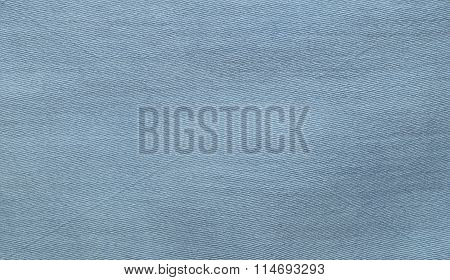 Light blue, turquoise denim texture. Fabric texture of the jeans. Closeup