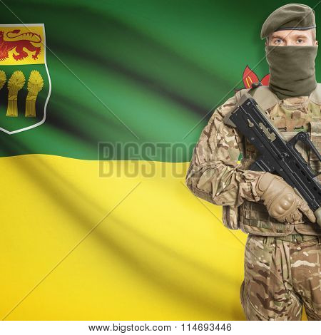 Soldier Holding Machine Gun With Canadian Province Flag On Background Series - Saskatchewan