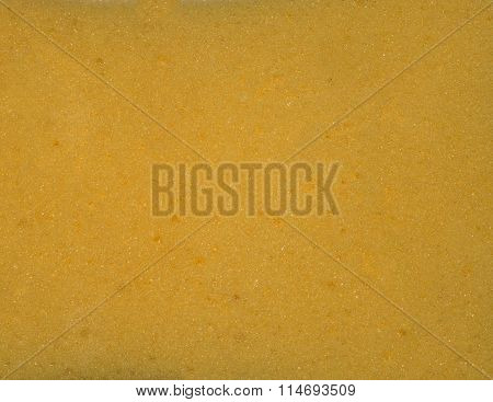 Yellow porous texture. The texture of the sponge. Closeup