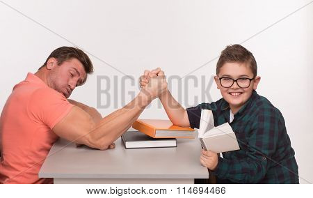 Young man and his son arm wrestling