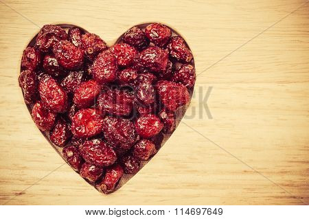 Dried Cranberry Fruit Heart Shaped On Wood Board