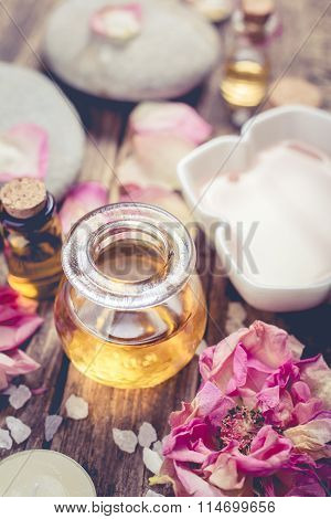 Massage Oil And Petals Flowers. Spa Concept.