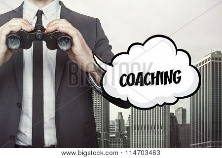 Coaching text on speech bubble with businessman holding binoculars