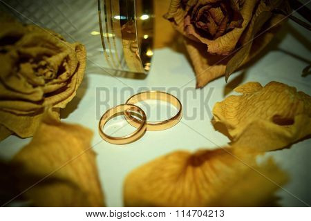Rings Flowers And Glass. Wedding Theme.