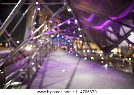 Blured view of the Helix Bridge at night