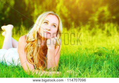 Beautiful Happy Dreamy Woman In Summer On Nature Lying On Grass
