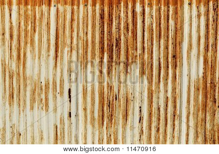 Rusty old corrugated iron fence