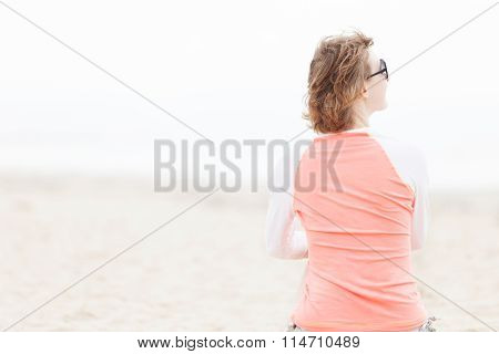 Woman In Rashguard